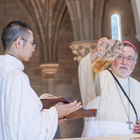 Bishop Pours Oil